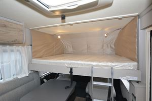 The upper bed in the Hymer Exsis-i 580 Pure motorhome
