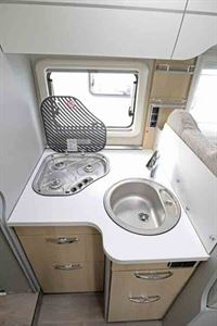 The kitchen, complete with circular sink and three burner gas hob © Warners Group Publications, 2019