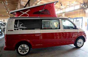 The all-new VW campervan from Westfalia has a distinctive red canvas in its pop-top roof
