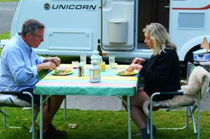 Rowland and Monica Rivron having dinner outside their Bailey Unicorn Vigo