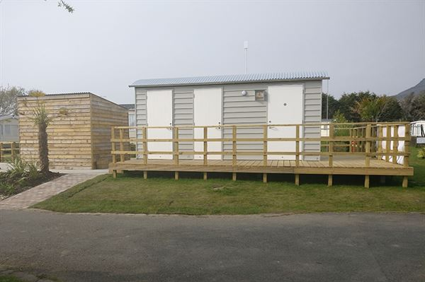 The wooden cabin housing the facilities