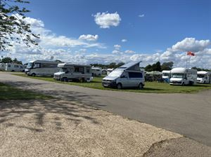 Motorhomes pitched up at the East of England National Motorhome and Campervan Sale in August demonstrates the grass camping pitches