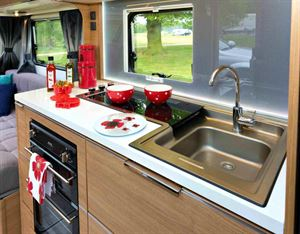 It's a great kitchen except that the sink, at 28cm x 30 cm, is smaller than those in most in caravans