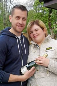 The newly-weds with their celebratory bottle of champagne
