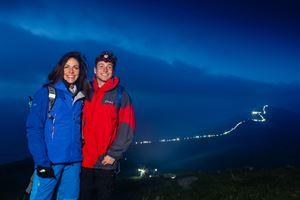 Julia Bradbury and Sam Thompson with Great Ridge illuminated in background (Credit: Ali Cusick)