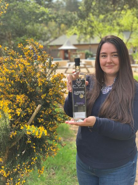 Kelling Heath Holiday Park's Assistant Reception and Reservations Manager Bethan Veary, who designed the label for Kelling Heath Stargazing Gin