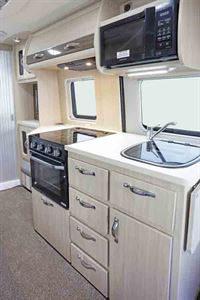The kitchen includes microwave, oven and grill - picture courtesy of Auto-Sleepers