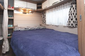 The bed area in the Knaus Northstar 590 caravan