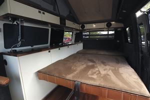 The bed in the Knights Custom Prestige Tourer campervan
