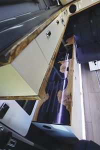 The stylish kitchen in the Knights Custom Prestige Tourer campervan