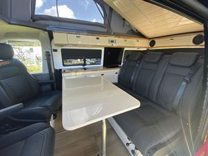 The lounge and table in the Knights Custom Prestige Tourer campervan