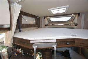 The drop-down bed over the lounge is available at extra cost