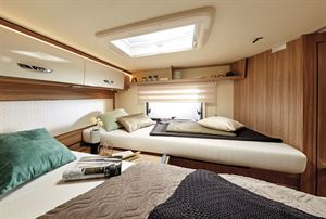 The rear bedroom features twin single beds