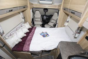 The front lounge converted to a bed in the Elddis Marquis Majestic 185 motorhome