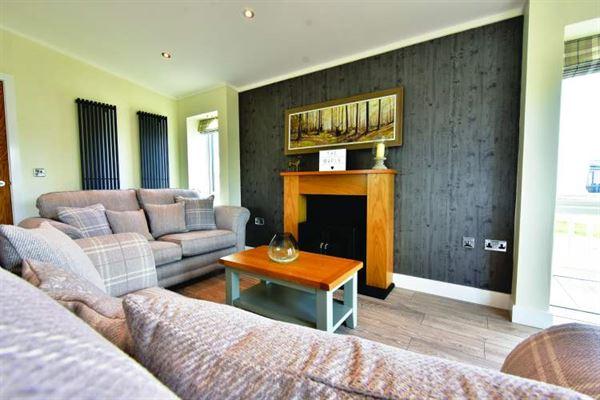 Oakwood Maple holiday home lounge