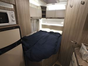 The bedroom in the Benimar Mileo 231 motorhome