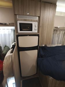 The fridge and microwave in the Benimar Mileo 231 motorhome