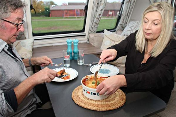 Rowland and Monica Rivron tuck in to their Aubergine Parmigiana