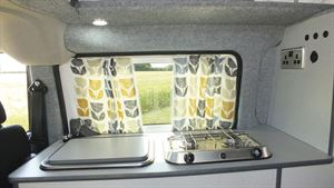 The kitchen in the Small Campervan Nissan e-NV200
