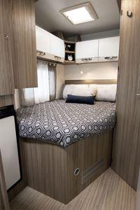 The bed in the Benimar Primero 331 motorhome