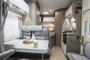 The interior of the Benimar Primero 331 motorhome, from front to rear