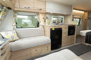 The Xplore 554 has pale upholstery and light woodwork