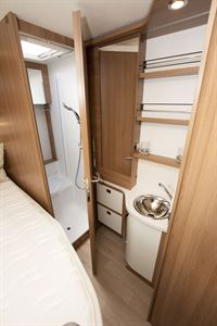 A view of the rear of the Rapido 656F motorhome, showing washroom and island bed