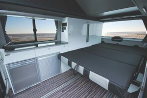 The bed area in the CMC Reimo campervan