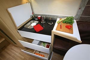 The kitchen design is new and practical