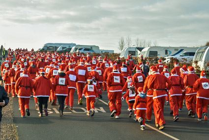 Santas head off in a sea of red at the start of the Salop Santa Dash at Love2Stay and Salop Leisure in Shrewsbury