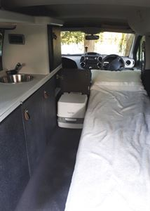 With the bed made up in the Stimson Free Spirit campervan