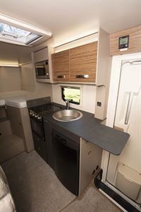 The kitchen in the Swift Edge 476 Black Edition motorhome