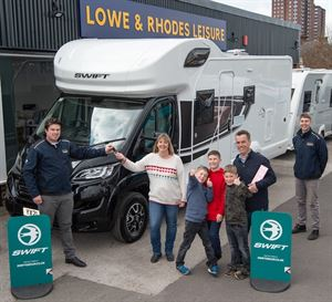 Catherine Lear and family being presented with their prize, a new Swift Edge 476 motorhome