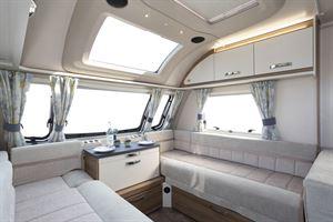 Settees in the lounge of the Swift Siena Super FB caravan