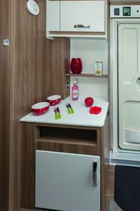 The dresser gives you lower and upper cabinets plus extra kitchen surface