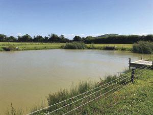 The fishing lake at Dulhorn Farm Holiday Park