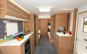 The long, wide corridor leads to the bunks, the offside dining area and the washroom
