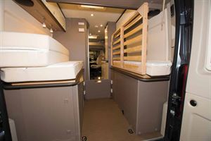 The bed folded to create storage space in the new Burstner City Car Harmony Line C 603 campervan