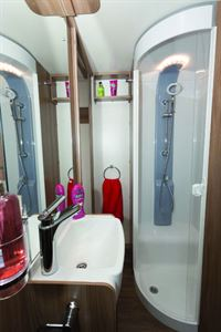 The shower is on the nearside, with towel hooks and a loop nearby
