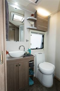The shower room occupies half of the width of the caravan