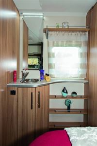 The vanity area has loads of cabinets and shelving making it very practical
