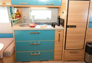 Three large drawers provide loads of lower kitchen storage