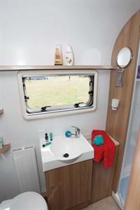Next to the sink is a deep cabinet, ideal for storing towels
