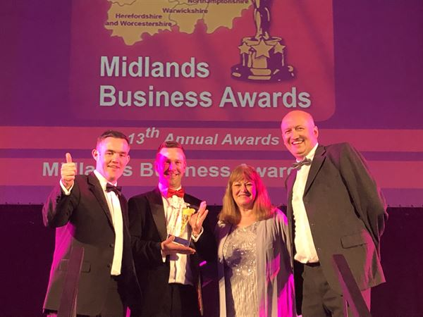 Nick Barner, Ross Edwards, Caroline Huggins and Erik Baxendale of Travelworld with the Family Business of the Year 2019 award