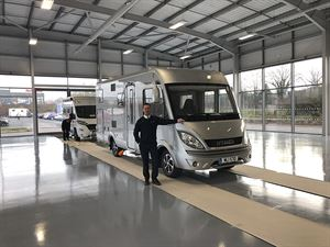 Travelworld MD Ross Edwards with the first Hymer in the new showroom