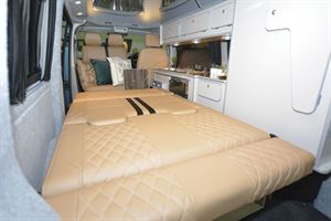 The fold down bed in the Tribe Campers East Edition campervan