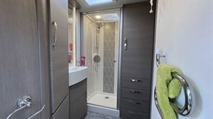 Wardrobes in the shower room of the Lunar Clubman ES caravan