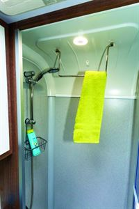A hinge-down towel rail in the shower