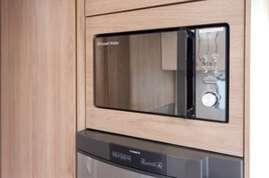 Unless you're of short stature you'll find the height of this mirror-finish microwave fine