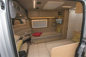 The nearside bed partly obstructs the door